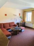 Rozkládací gauč v obývacím pokoji