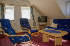 Podkrovní obývací pokoj s rozkládacím gaučem